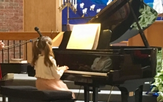 Young female student playing piano