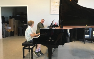 Piano teacher and student during piano lesson